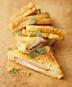 Several toasted ham and cheese sandwiches