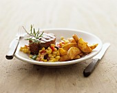 Beef medallion with sweetcorn salsa and potato wedges