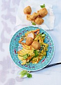 Vegetable curry with cod fillet and stir-fried noodles (Asia)