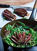 Teriyaki-glazed rump steak on sugar snap peas