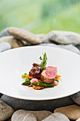 Medallion of lamb and glazed breast of lamb with spring vegetables