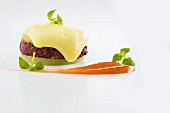 A layered dish of blood sausage and liver sausage with braised apple, apple sauce and potato foam