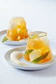 Wine jelly with lemon verbena, melon balls and sabayon
