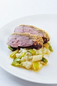 Duck breast with chestnut crust on spring onion risotto