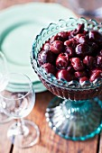 Bowl of cherries on table