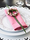 Elegant place setting with napkin and flower wreath