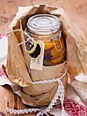 Jar with preserved orange slices