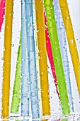 Colorful drinking straws in glass of water