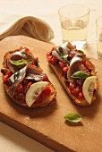 Toasted bread with tomatoes and pickled anchovies, Italy