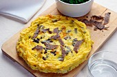 Black truffle s omelette with Cicorino salad, Italy