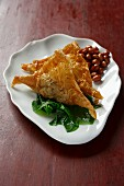 Spinach turnovers with peanuts