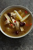 Vegetarian chicken soup with potatoes, red dates and goji berries