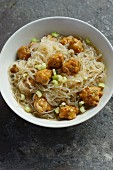 Rice noodles with vegetarian dumplings and celery