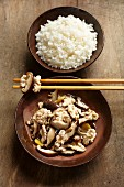 Walnuts with shiitake mushrooms served with rice