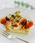 Onion quiche with mixed barbecued skewers