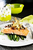 Salmon fillet with tomato oil on asparagus
