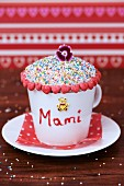 Cupcake for Mother's Day in a coffee cup with red hearts and a teddy bear