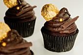 Chocolate ganache cupcakes with a chocolate ball
