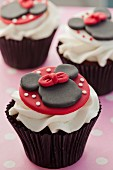 Chocolate cupcake decorated with Minnie Mouse and buttercream