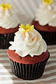 Red Velvet cupcake with cream cheese frosting and a sugar flower, for a wedding