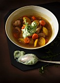 Carrot stew with yellow turnips, pork and creamed rocket sauce