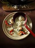 Cream of horseradish soup with zander and prawns