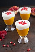 Mango purée with yoghurt and pomegranate seeds