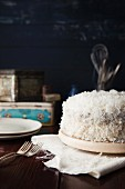 Carrot cake with cream cheese frosting and grated coconut