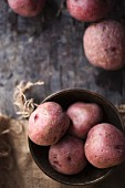 Red potatoes in a metal bowl (view from above)