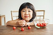 Girl eating cherries, portrait