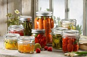 Variety of fruit and vegetables pickled in jars