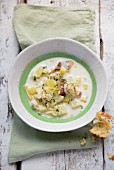 Leek and potato soup with celeriac and smoked fish