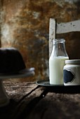 A bottle of milk on a wooden table