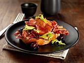 Streaky bacon with tomato, lettuce, black olives, peppercorns and shredded beetroot on brucshetta