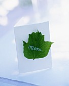 A menu decorated with a leaf