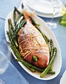 Baked gilt-head bream with green asparagus and chives