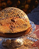 A tart with a dome of caramel threads