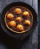 Apple tart in a cast iron pan