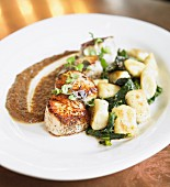 Seared scallops with greens and dumplings