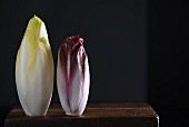 Chicory and red endive on a wooden table