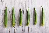 Six okra pods in a row