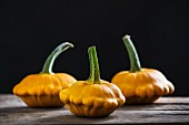 Three yellow patty pan squashes