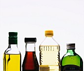 Four different oils in bottles (section)