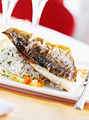 Fried gilt-head bream on herb rice