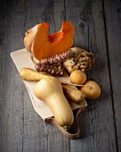 Assorted autumn vegetables on a chopping board