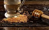Ingredients for honey mustard dressing: honey, apple vinegar and mustard seeds