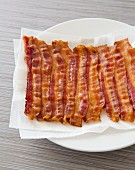 Cooked Bacon Resting on a Plate with Paper Towels