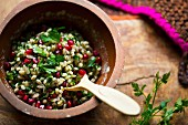 Pearl barley salad with pomegranate with parsley