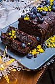 Beetroot and chocolate cake with blueberries and edible mimosa