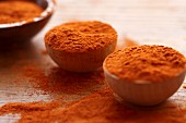 Paprika in small wooden bowls